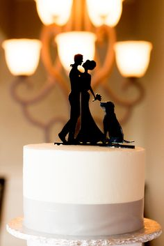 Silhouette cake topper with golden retriever by their side!  Venue: Brookside Golf Club on Cape Cod. Photography: meredithjanephoto.com