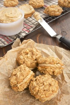 Chewy oatmeal cookies are filled with a rich butterscotch frosting for a delicious cookie experience. - Bake or Break