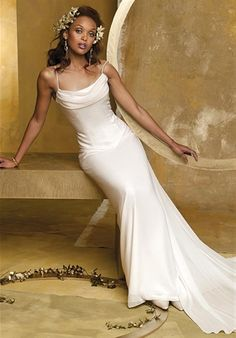 Camille La Vie & Group USA  Gown features beading and cowl neckline.  Silhouette: Sheath  Waist: Basque  Gown Length: Floor  Train Style: Detachable  Train Length: Sweep  Sleeve Style: Spaghetti Straps  Fabric: Chiffon  Embellishments: Beading  Color: Ivory  Size: 2 - 22  Price: $