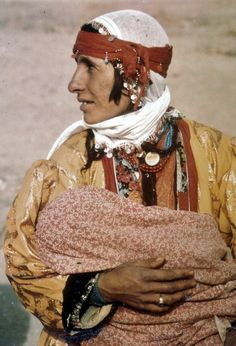 Kurdish village woman in daily dress, with child.  Van province, 1973.