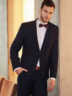 Elegant and universal styling from the Bolf collection for important events. The navy blue men's suit goes well with a classic white shirt. This outfit is lighten up by the red and navy blue bow tie.