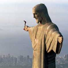 What is this guy thinking, as he prepares to base jump off the statue of Christ the Redeemer in Rio...