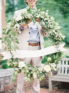 wedding wreath. could use a hula hoop and gather greens and flowers. Attach with wire.