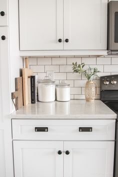 Kitchen curtains + counter styling ideas from home + lifestyle blogger Liz Fourez