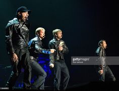 AHOY Photo of BACKSTREET BOYS and Brian LITTRELL and Nick CARTER and AJ McLEAN and Howie DOROUGH, Group performing on stage, leather jaclets L-R AJ McLean, Brian Littrell, Nick Carter and Howie Dorough