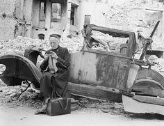 15 Oct 1945, Berlin, Germany --- German Woman Knitting Among Ruins,Berlin 1945