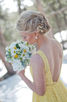 Bridesmaid in yellow lace dress.
