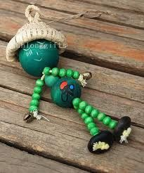 lil bead people made with wooden beads and twine.