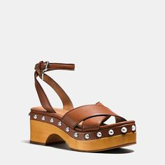 Den COACH Astor Clog entdecken. Kostenloser Versand und Rücksendungen! Entdecken Sie Designer-Taschen, Portemonnaies, Schuhe und mehr auf COACH.com!