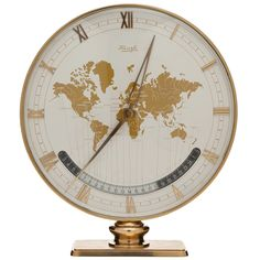 Large Kienzle Global Desk/Table Clock c.1960 #1960s #midcentury #map #globe #clock #antique #gold #rare #gift (via @1stdibs)
