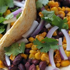 Perfect for Meatless Mondays, this black bean taco recipe combines with our roasted corn recipe for a scrumptious meat-free meal option.