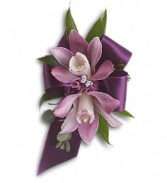 "Purple miniature cymbidium orchids, lavender waxflower, Italian ruscus and parvifolia eucalyptus. 23    Approximately 4 1/4"" W x 7"" H."