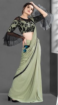 Imported Lycra Bell Sleeve Style Ready to Wear Saree New Saree Blouse Designs, Saree Jacket Designs, Saree Tassels Designs, Blouse Patterns, Simple Sarees, Trendy Sarees, Stylish Sarees, Sleeves Designs For Dresses, Sleeve Designs
