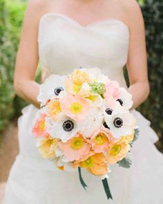 24 Best Spring Wedding Bouquets | Martha Stewart Weddings - The couple's florist, Nature Composed, used anemones and Icelandic poppies framed in dusty miller for the bride's bouquet. The spring color palette was originally inspired by this peaches and cream story, with other soft pastels coming into play as the design developed.