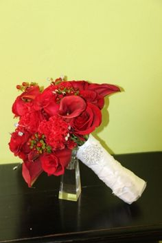 Bridal bouquet of red roses, miniature calla lilies, hypericum berries, celosia and bling by Beautiful Blooms by Jen.