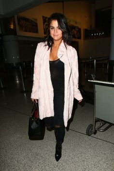 Selena Gomez wearing Nasty Gal Candy Girl Faux Fur Coat, J Brand Photo Ready Distressed Alana Cropped Jeans and Louis Vuitton Fall 2015 Ankle Boots