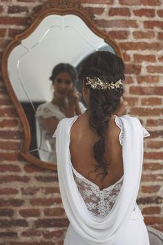 Beautiful draped back wedding gown | Pin discovered by Kelly's Closet bridal boutique in Atlanta, GA