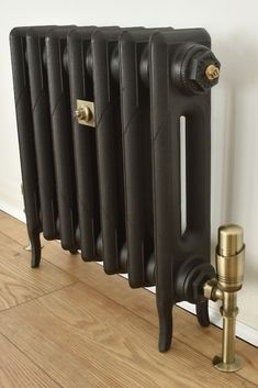 We think the Rook cast iron radiator looks amazing in a Metallic Anthracite finish with Antique Brass thermostatic radiator valves! This will definitely be eye catching in any room, and has an extremely effective heat output. Home Radiators, Cast Iron Radiators, Painting Radiators, Kitchen Radiators, Radiator Valves, Radiator Cover, Living Room Cupboards, Painted Radiator, Traditional Radiators