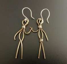 Hey, I found this really awesome Etsy listing at http://www.etsy.com/listing/177114637/people-earrings-in-vintage-brass-and