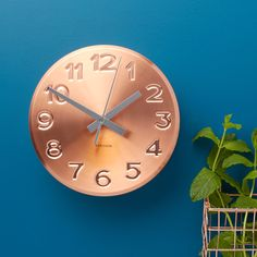 Shiny and bold with chrome clock hands, this copper wall clock would look great on a kitchen wall. (Copper Kitchen Wall Clock, £34, The Contemporary Home). Find more metallics and copper inspiration at housebeautiful.co.uk