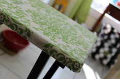 Mod Podge fabric over my boring tv trays. YES.