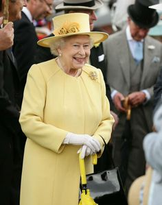 Her Majesty meets guests during a garden party held at Buckingham Palace on June 3, 2014