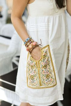 Fun embroidered patch pocket on a white dress