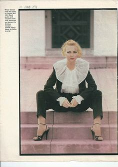 White blouse with net collar by Janice Bell. Black jacket and trousers by Stirling Cooper. Shoes by Bilbo.  19 Magazine June 1978