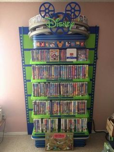 """I was told you would like this. It's my mom's Disney movie collection. She isn't missing many, and even has the Sing-Alongs on the side of this case"" THIS IS JUST DISNEY GOALS 😍 Deco Disney, Disney Fun, Disney Magic, Disney Frozen, Disney Ideas, Disney Home Decor, Disney Crafts, Disney Room Decorations, Disney And Dreamworks"