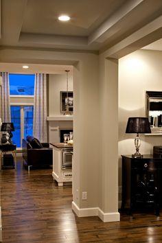 Gray and white walls with dark hardwood floors.