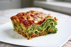 Spinach & Ricotta Lasagna 14 no-boil lasagna noodles 4 packed cups chopped spinach (about 300g)* 2 tbsp oil  1 onion, chopped 5 cloves garlic, minced 1/2 white bell pepper, chopped 60g parmesan cheese 100g mozzarella cheese 2 eggs 400g ricotta cheese 2 cups pasta sauce 1/3 tsp salt  pinch ground pepper