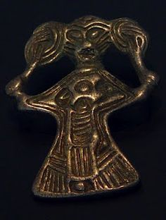 Silver Valkyrie figure with slanted eyes found in Denmark, dated to Iron Age. Exhibited at the National Museum of Denmark.