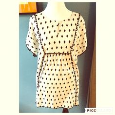 """Cotton Embroidered Tunic Dress You will be ready for summer in this great, 100% cotton dress by J Crew. Featuring black embroidery detailing , a black diamond print, and a light, breezy fit, this dress is perfect for the hot weather.  Chest measures 19""""; length is 30"""". J. Crew Dresses"""