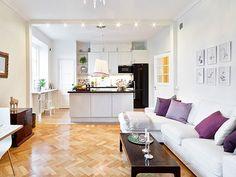 cocina abierta pequeña integrada en salon