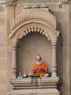 Varanasi, India - design details on the arch of where he is sitting
