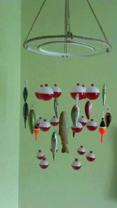 I fell for this hook, line and sinker! Bobber and fish mobile. Baby fish themed nursery. Embroidery hoops spray painted white with jute twine hot-glued....you could even use a lamp shade frame for this too! Re-Scape.com