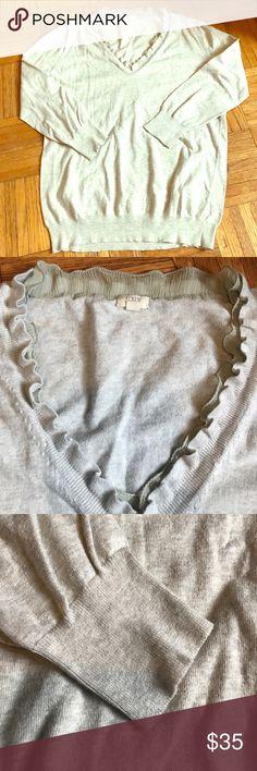 J. Crew Ruffle Neck Sweater Size Large J. Crew ruffled neck sweater. Sweater is 100% cotton and ruffles around the neck is 100% silk. Size Large J. Crew Sweaters V-Necks