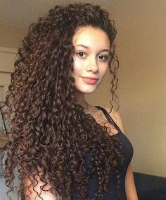 Top 14 Spectacular Long Curly Hairstyles for Women to Get An Ideal Look This Year
