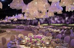 Silver seating with white chandeliers & great lilac flower centrepieces with high end silver wear ... Lighting is subtle in white n violet giving a gorgeous, romantic ambiance