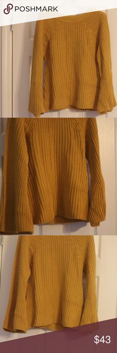 Mustard Knit Sweater Mustard Knit sweater with long sleeves in popular bell sleeve construction. Sweaters