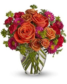 How sweet it will be when this dazzling arrangement arrives at someone's door. Very vibrant. Very vivacious. And very, very pretty. Light orange roses, orange spray roses, and matsumoto asters, hot pink miniature carnations and more are delivered in a lovely glass vase. Be sweet and send this one today! Fast Flowers, Summer Flowers, Beautiful Flower Arrangements, Beautiful Flowers, Fresh Flower Delivery, Order Flowers Online, Mylar Balloons, Orange Roses, Spray Roses