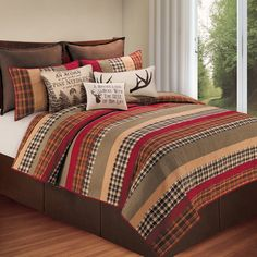 Cozy up with this soft Boulder Ridge quilt. This patchwork quilt is available in a variety of sizes and features an array of colors in a tasteful design.