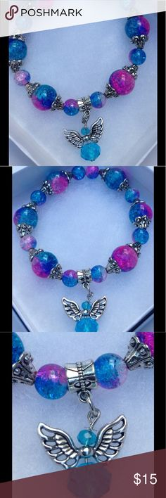 """Blue and Pink Sparkly Angel Bracelet This lovely bracelet is made with sparkling blue and pink duotone glass beads. It is on elastic and will stretch to fit up to a 7.5"""" wrist.   All PeaceFrog jewelry items are handmade by me! Let me know if you need me to adjust the size. Take a look through my boutique for coordinating jewelry and more unique creations. PeaceFrog Jewelry Bracelets"""
