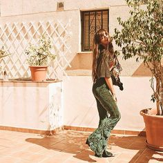 To be living in paradise would be a dream... until then at least a pair of Emerald Vana Flares can frolic in the Spanish sunshine with the tropical fruits parrots warm ocean & @katarakagurais  Find your pair of shimmering velvet flares on Etsy: Flare Street