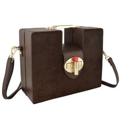 Iris-Walnut-Brown-by-OYSBY Stylish oversized trunk clutch design made of a combination of smooth hair on hide and smooth Napa leather finished with the signature OYSBY lipstick clasp closure.