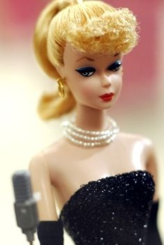 Love Barbie dolls - One of the original Barbie dolls...my mom used to buy them and have them displayed on her bed...during the 1960's.