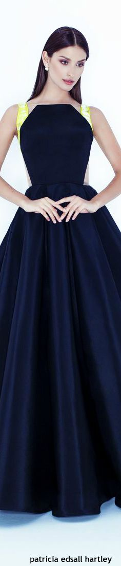 Cristiana Savulescu. This is so pretty. I love the yelllow straps with the formal navy.