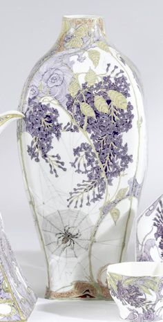 ROZENBURG SQUARE SECTION BALUSTER VASE 1901 by S. Schellink, painted on the front and reverse with a brown spider in its web amidst flowering lilac, the sides with further lilac branches, printed factory mark, painted year code, decorator's mark and work order number 950, molded shape number 121. Hairlines. height 11in. (28cm) UNSOLD