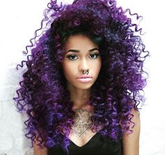 You can't go wrong with a deep purple. The fade doesn't leave your hair looking as dry and damaged, which is already a struggle for people with curly hair.