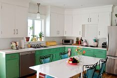 Love how only the lower cabinets are painted green - it helps to ground the space.